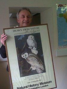 Steve Carroll holding a print from Audubon's Birds of America