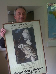 Steve Carroll holding a print from Audubon's Birds of America