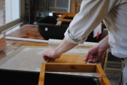 The screen is removed from the mould and the sheet is transferred to a felt.