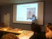 John Bidwell lecturing in class.