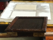 The papers are transferred from the mould to the felt.