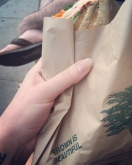 Panini at Bondhi Beach served to-go in recycled paper